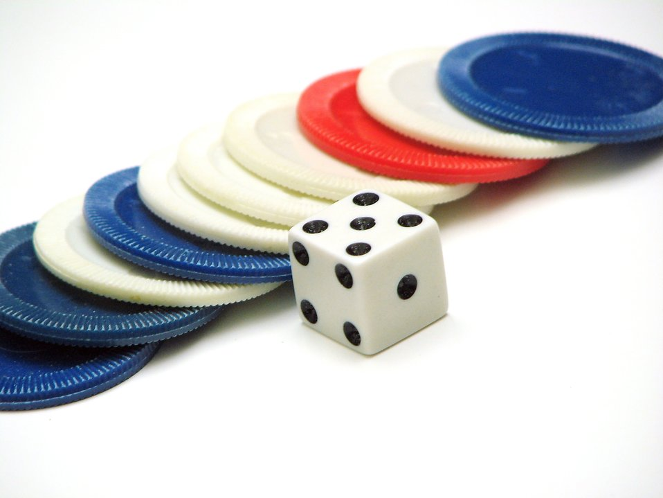 Poker chips and a die : Free Stock Photo
