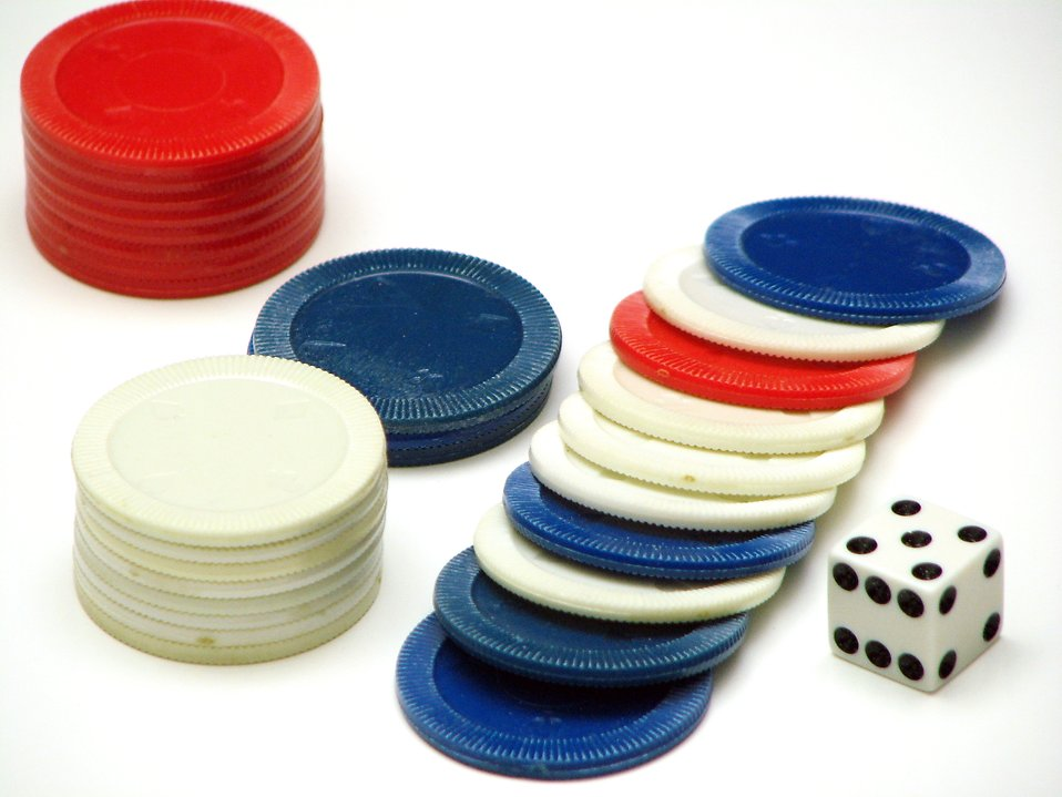 Red white and blue poker chips and a die : Free Stock Photo