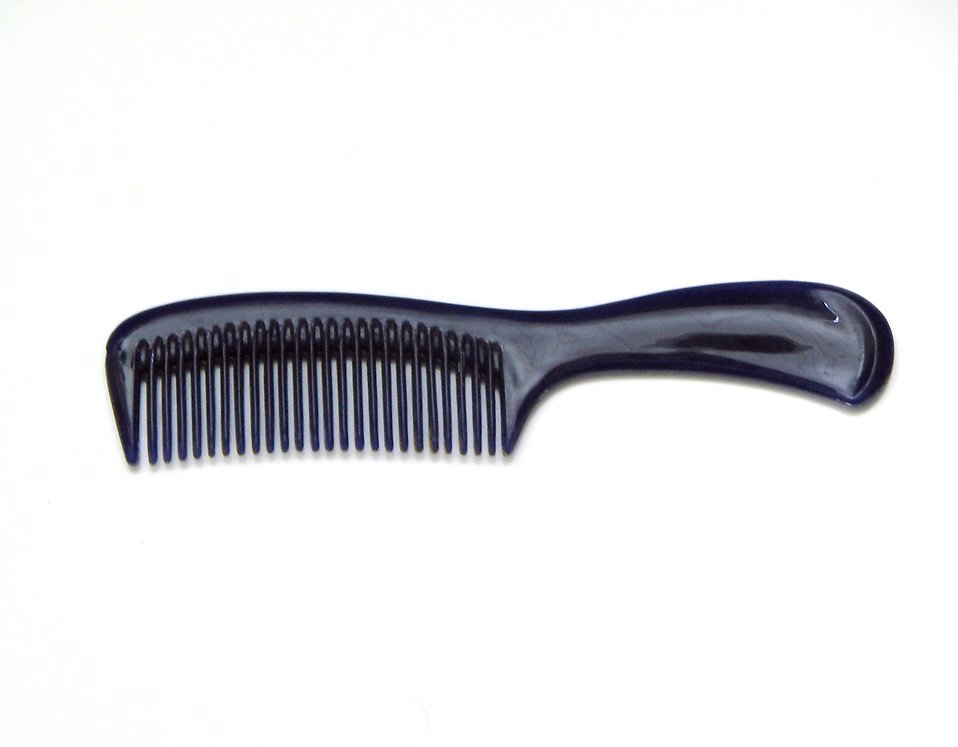 Black comb on a white background : Free Stock Photo