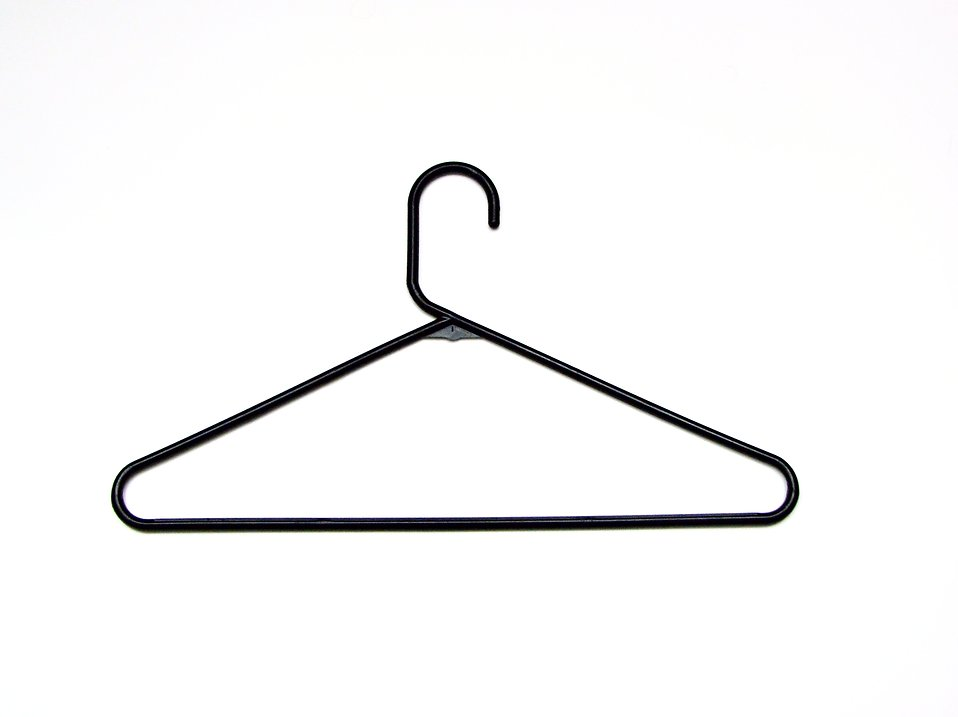 Black plastic coat hanger : Free Stock Photo
