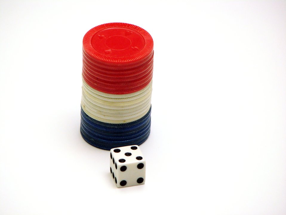 Stack of poker chips and a die : Free Stock Photo