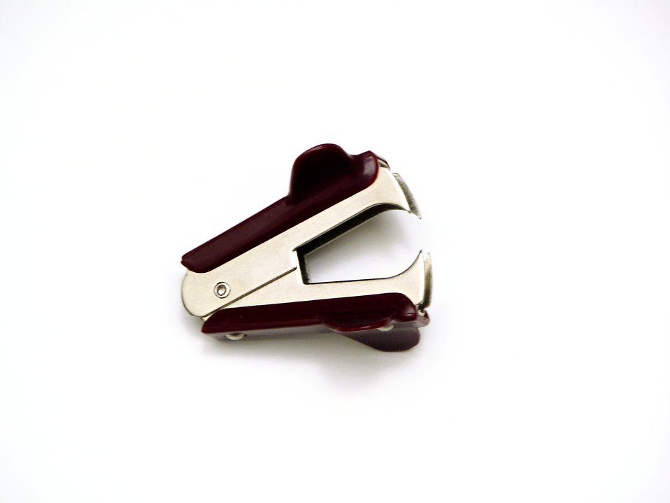 Brown staple remover on white background : Free Stock Photo