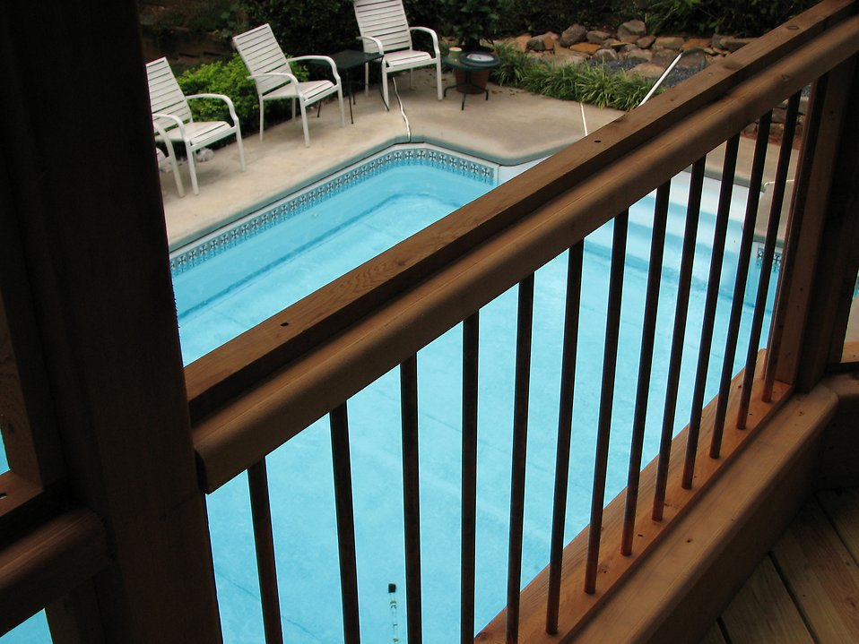 View of a swimming pool from a deck : Free Stock Photo