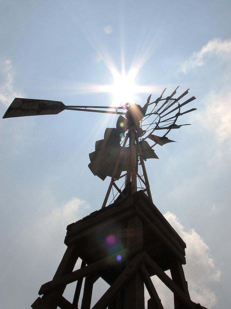 An old farm windmill shining under the sun : Free Stock Photo