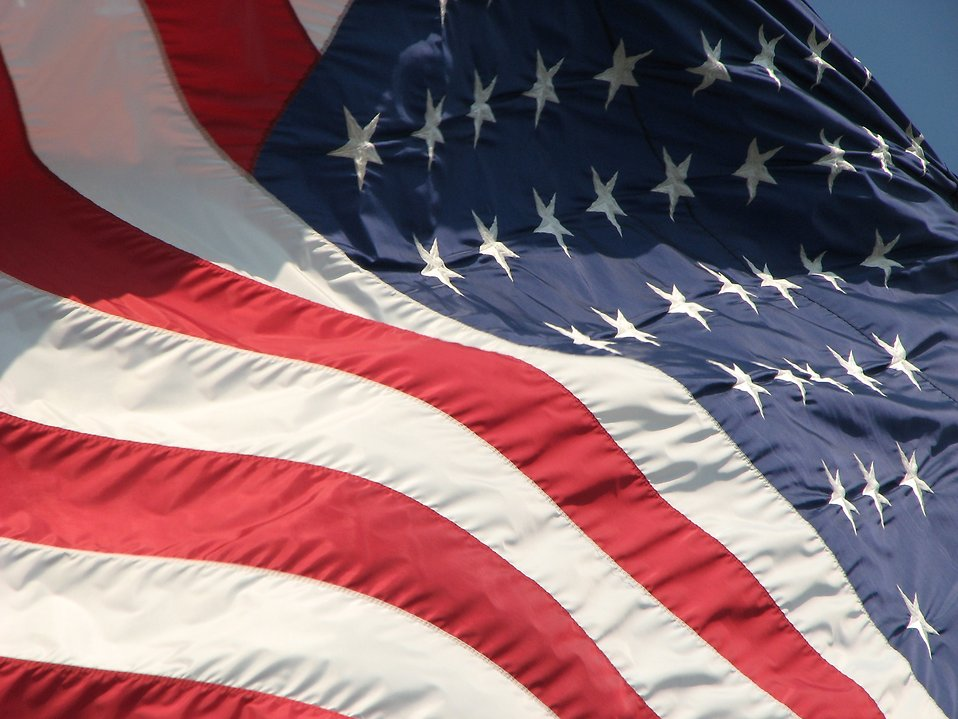 Closeup of a US flag flying in the wind : Free Stock Photo