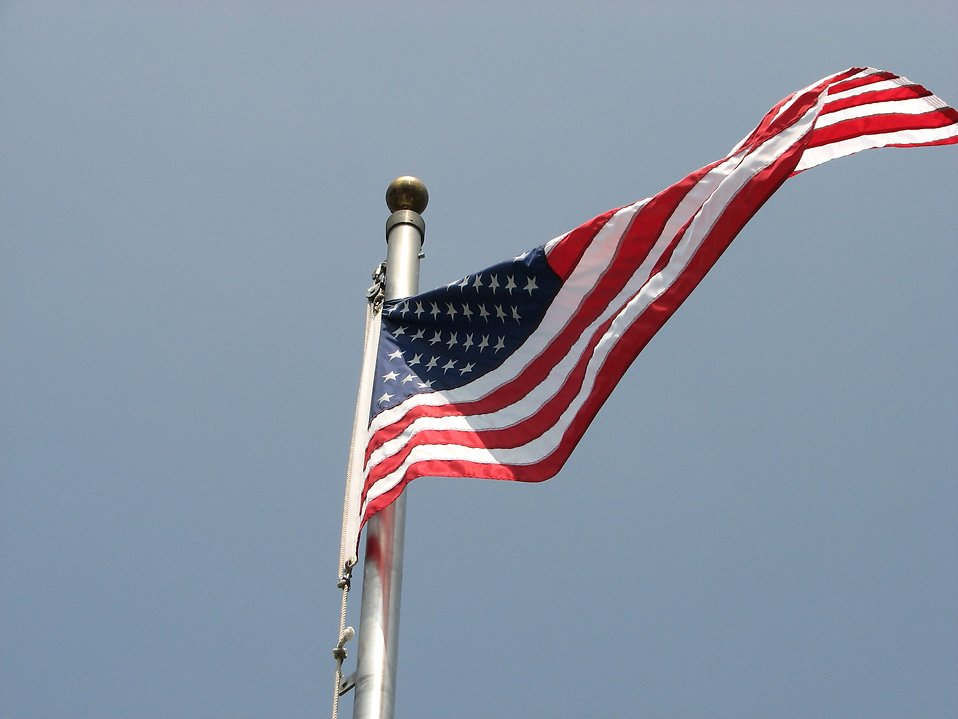 An American flag flying in the wind : Free Stock Photo