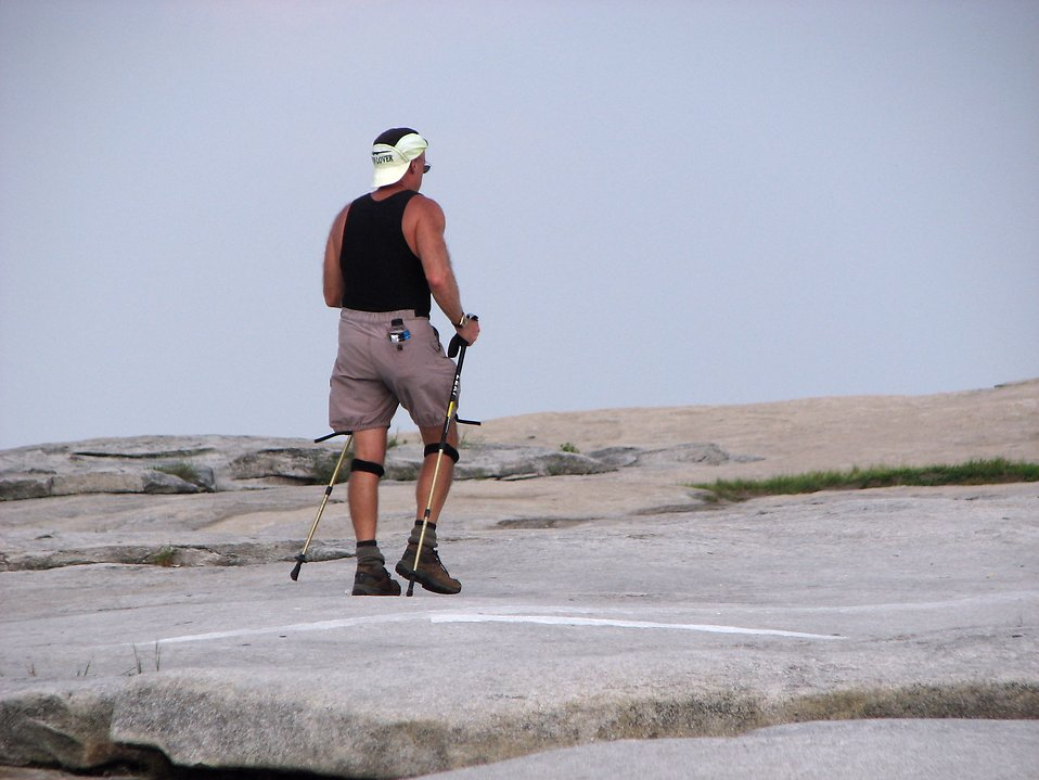 Man hiking on top of Stone Mountain : Free Stock Photo
