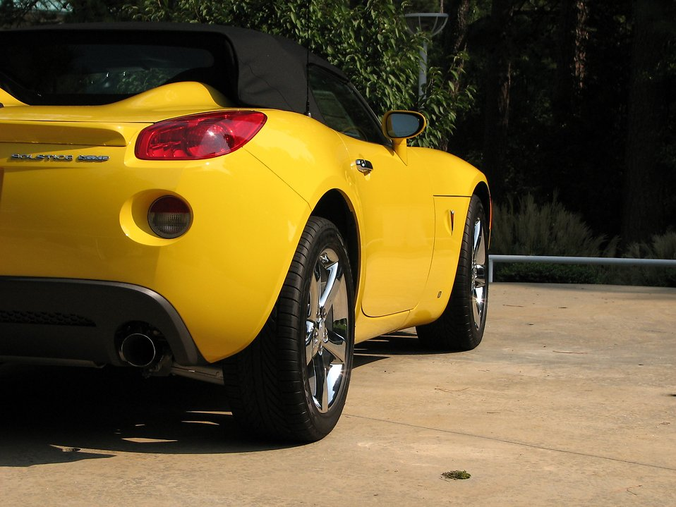 Side view of a yellow sports car : Free Stock Photo