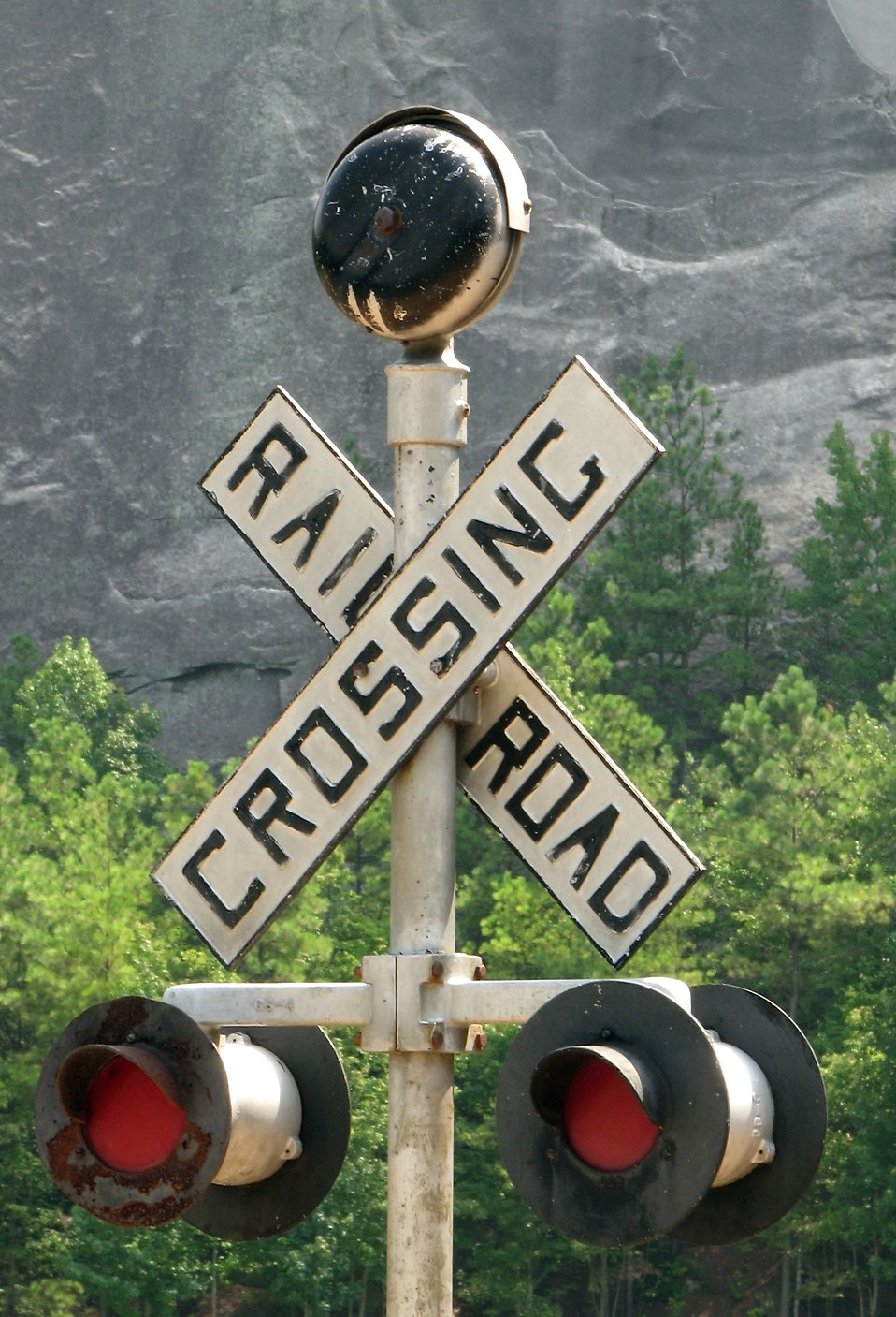 Closeup of a railroad crossing sign : Free Stock Photo