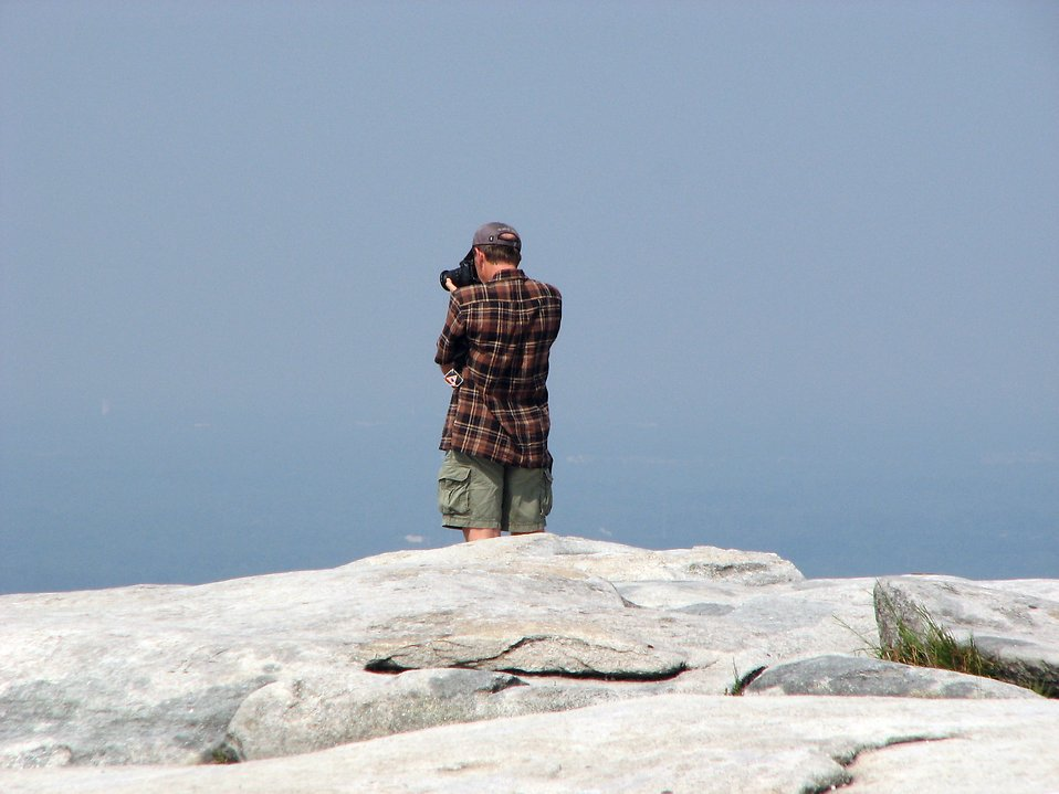 Tourist taking a picture from the top of Stone Mountain : Free Stock Photo