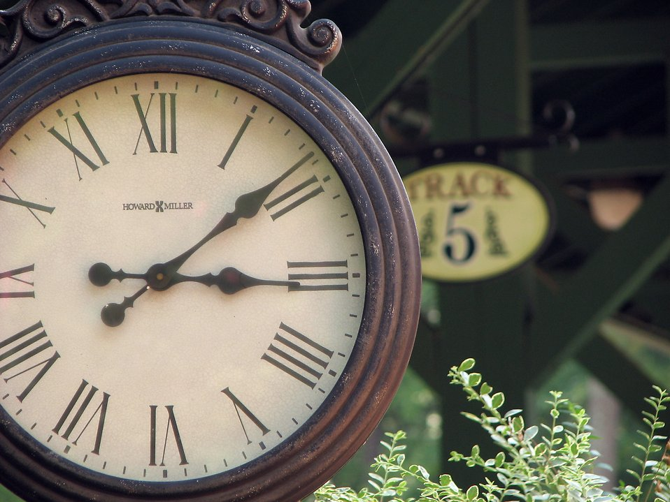 Closeup of a clock at a railroad station : Free Stock Photo