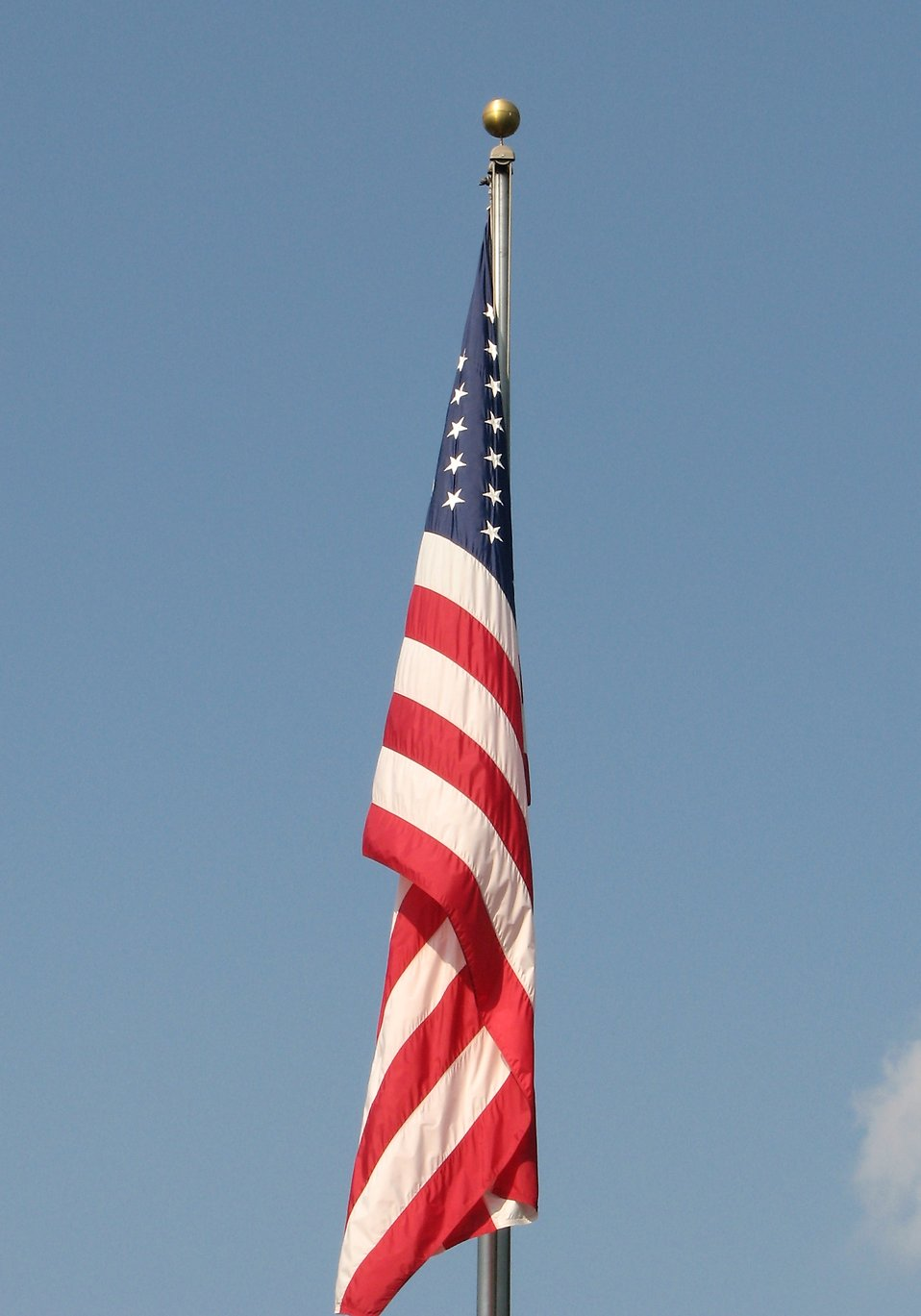 US flag on a flag pole with no wind : Free Stock Photo