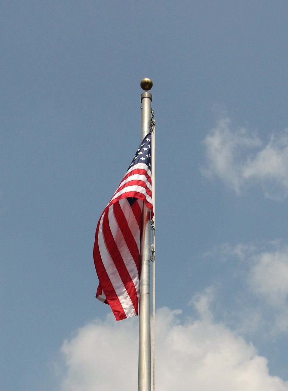 US flag on a pole with blue sky background : Free Stock Photo