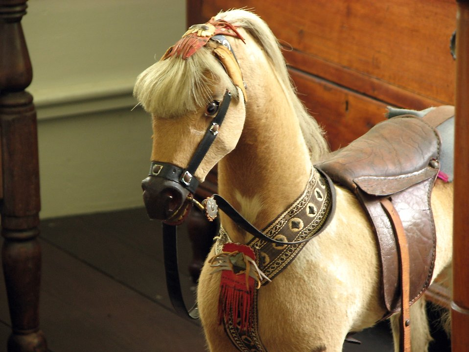 Closeup of an old toy horse : Free Stock Photo
