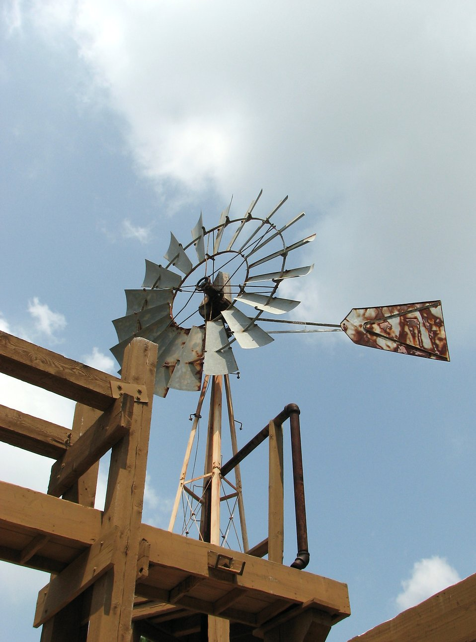 An old farm windmill in a blue cloudy sky : Free Stock Photo