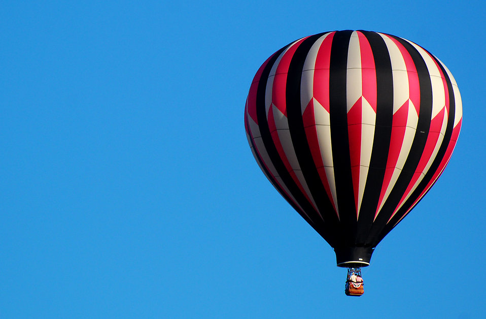 A hot air balloon in a blue sky : Free Stock Photo