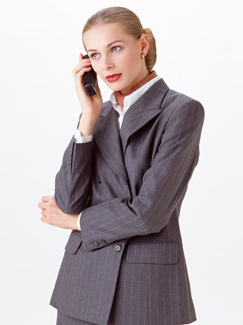 A beautiful blonde businesswoman on a cell phone isolated on a white background : Free Stock Photo