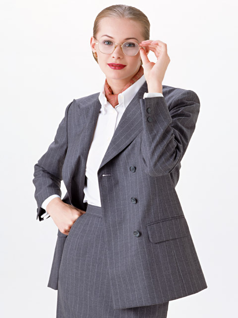 A beautiful blonde business woman in a suit isolated on a white background : Free Stock Photo