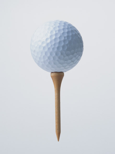 A golf ball on a tee isolated on a white background : Free Stock Photo