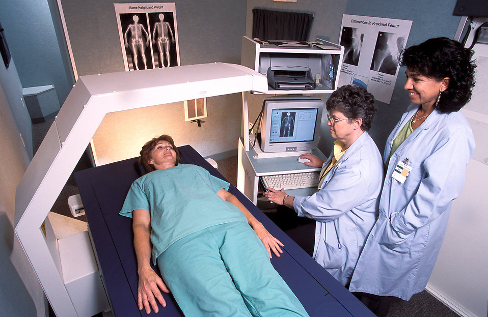 Researchers preparing to x-ray a patient.