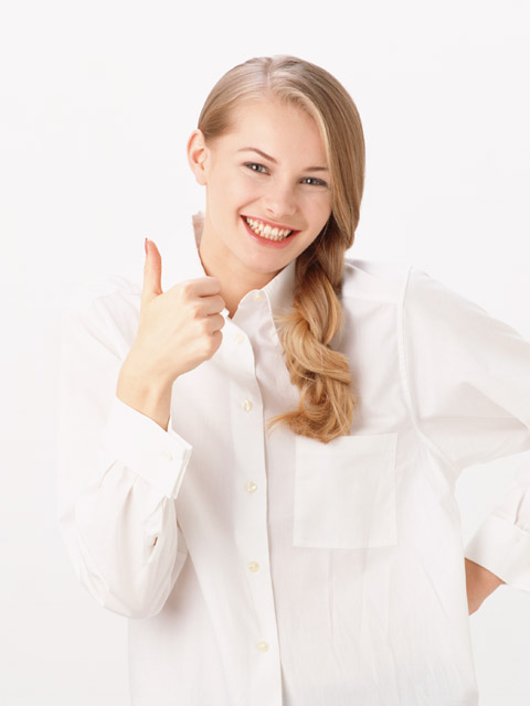 A beautiful blonde giving a thumbs up isolated on a white background : Free Stock Photo