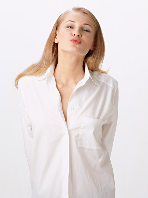 A beautiful blonde in a white shirt isolated on a white background : Free Stock Photo