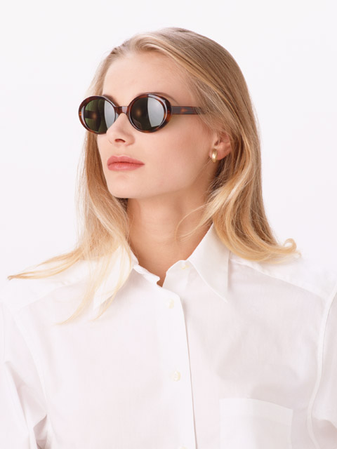 A beautiful blonde wearing sunglasses isolated on a white background : Free Stock Photo