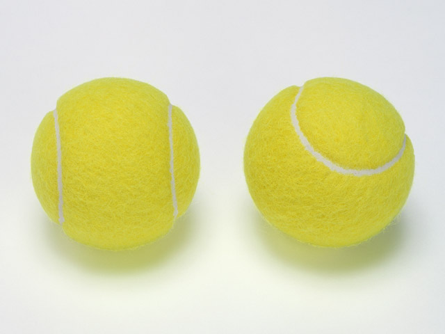 A pair of tennis balls isolated on a white background : Free Stock Photo