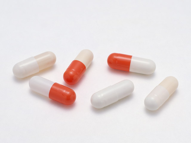 Pill capsules isolated on a white background.