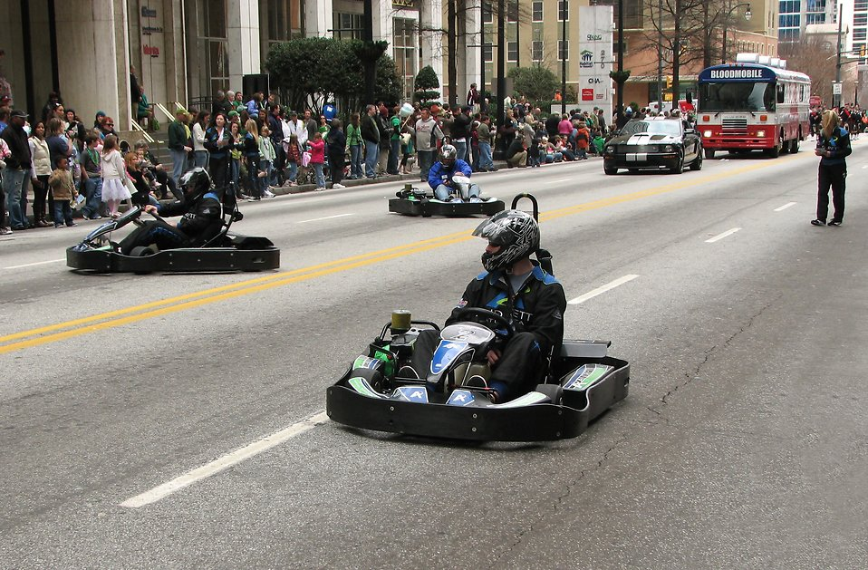 Men in go-karts at the 2010 Atlanta Saint Patrick's Day Parade : Free Stock Photo