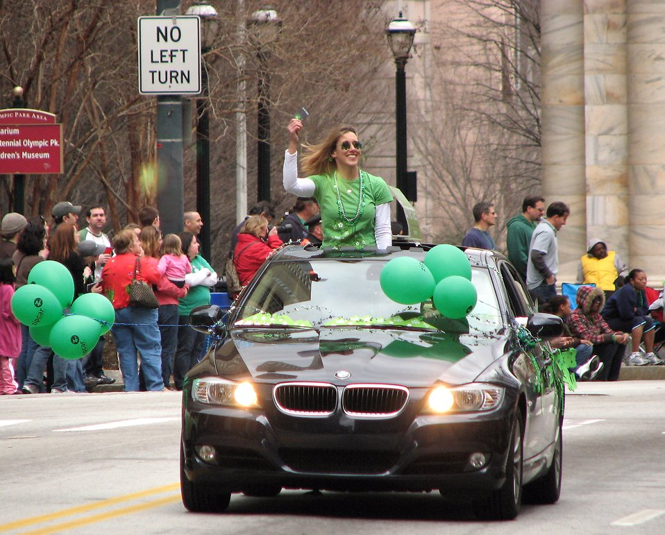 A woman in a car in the 2010 Atlanta Saint Patrick's Day Parade : Free Stock Photo