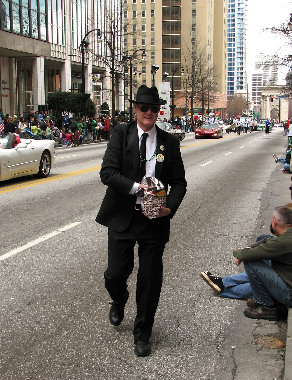 A man passing out candy at the 2010 Atlanta Saint Patrick's Day Parade : Free Stock Photo
