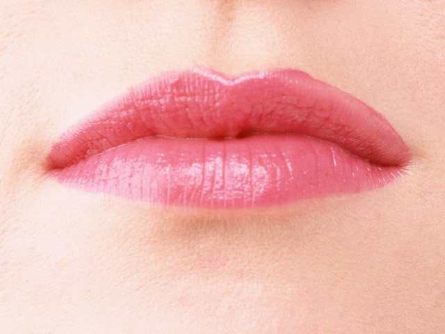 Close-up of a woman's mouth and lips with pink lipstick : Free Stock Photo