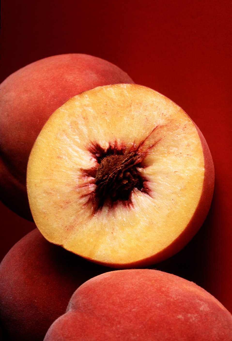 Sliced and whole Autumn Red peaches : Free Stock Photo