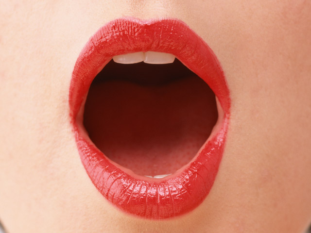 Close-up of a woman's open mouth and lips : Free Stock Photo