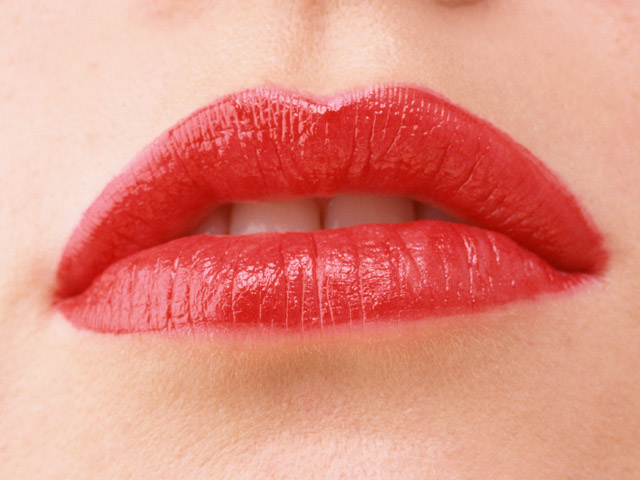 Close-up of a woman's mouth and lips with red lipstick : Free Stock Photo
