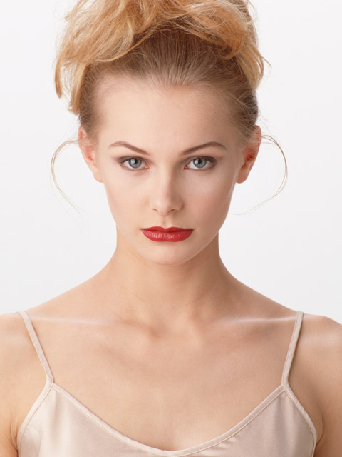 A beautiful blonde isolated on a white background : Free Stock Photo