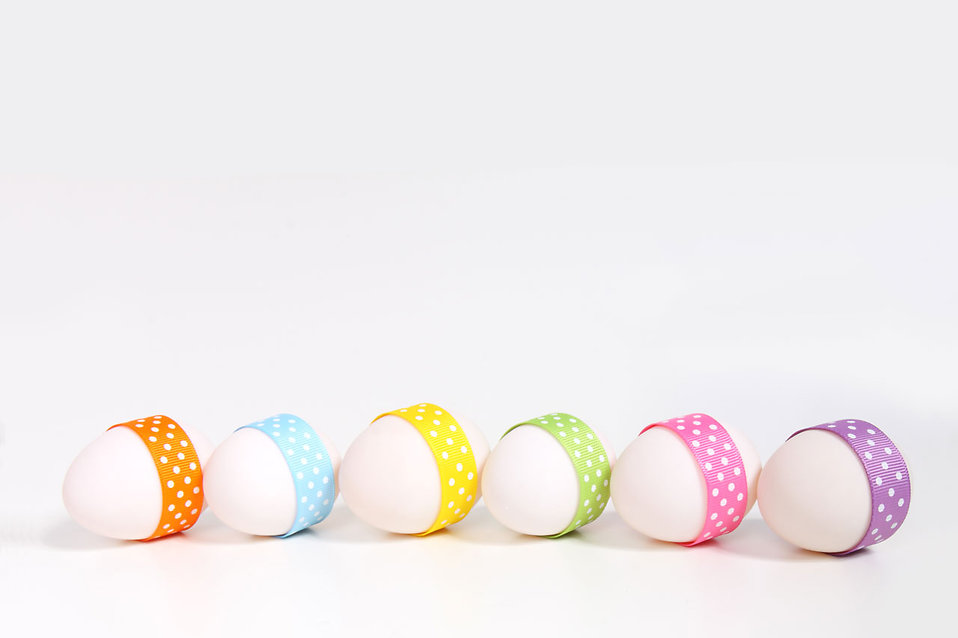 A line of easter eggs with ribbons isolated on a white background : Free Stock Photo