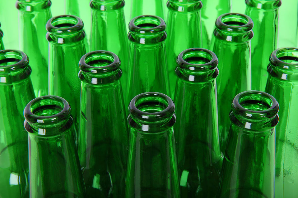 Empty green beer bottlenecks.