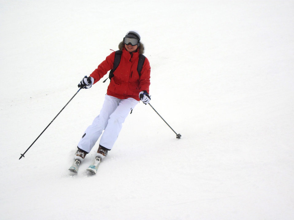 A woman snow skiing.