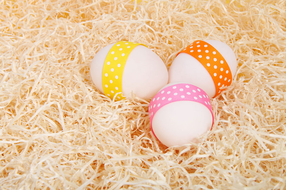 Easter eggs with ribbons on straw : Free Stock Photo