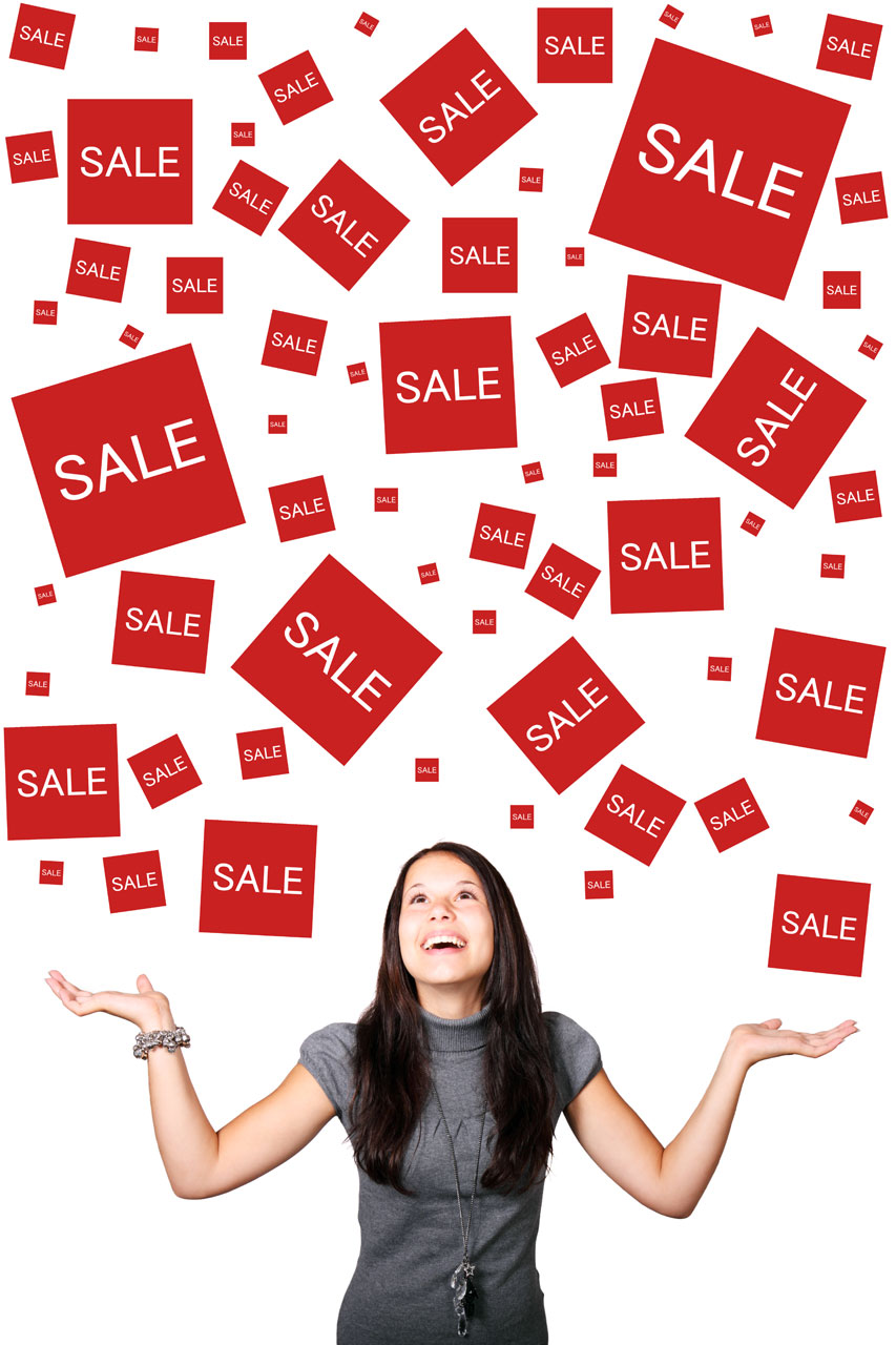 A beautiful girl enjoying sales signs : Free Stock Photo