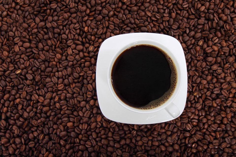 A cup of coffee on a bean background : Free Stock Photo