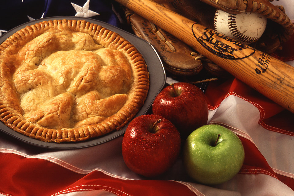 An American pie display with apples, a flag, and baseball equipment : Free Stock Photo
