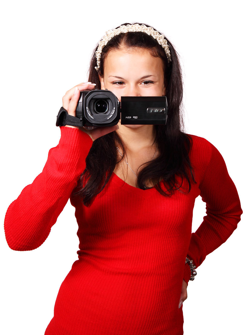 A beautiful woman with a video camera : Free Stock Photo