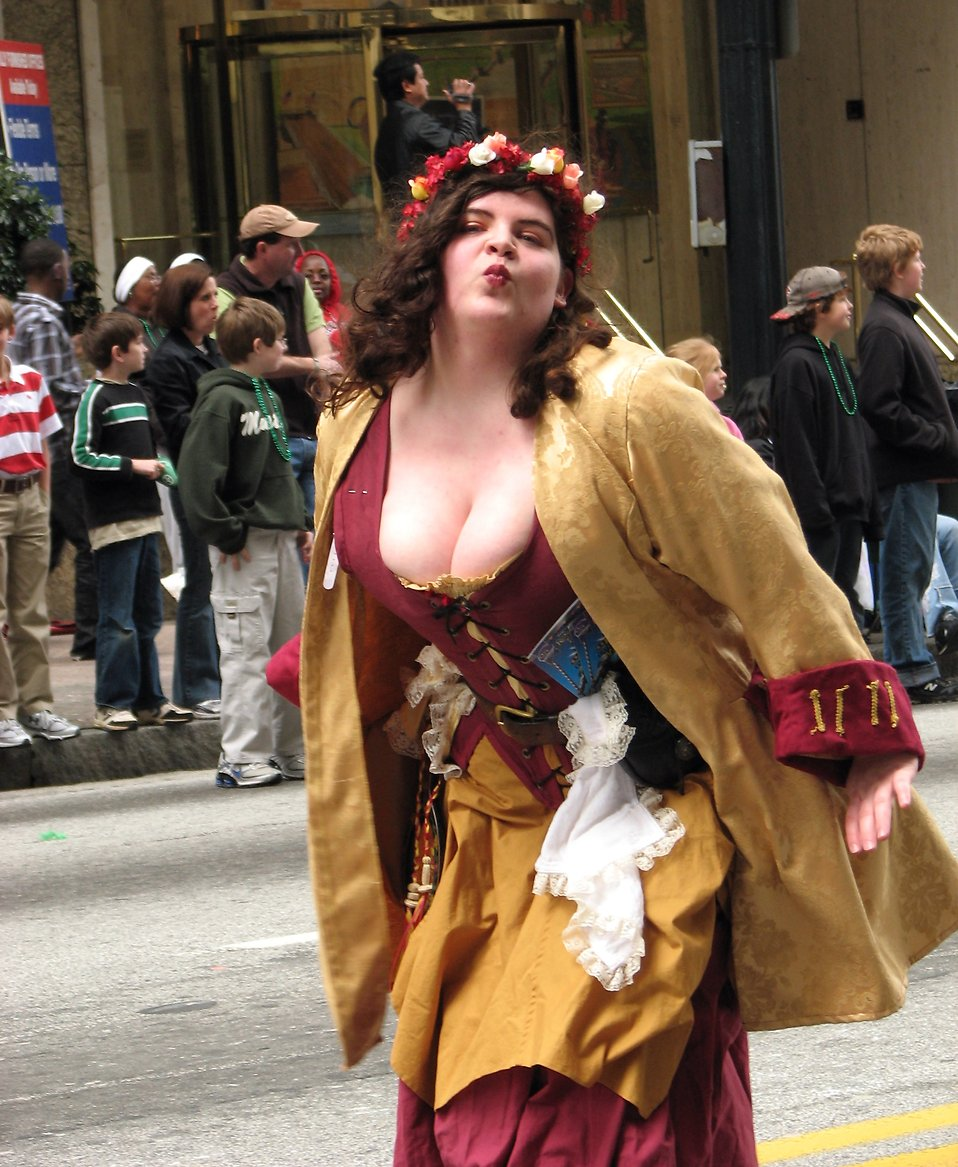 A medieval costumed woman blowing a kiss in the 2010 Saint Patricks Day Parade in Atlanta, Georgia.