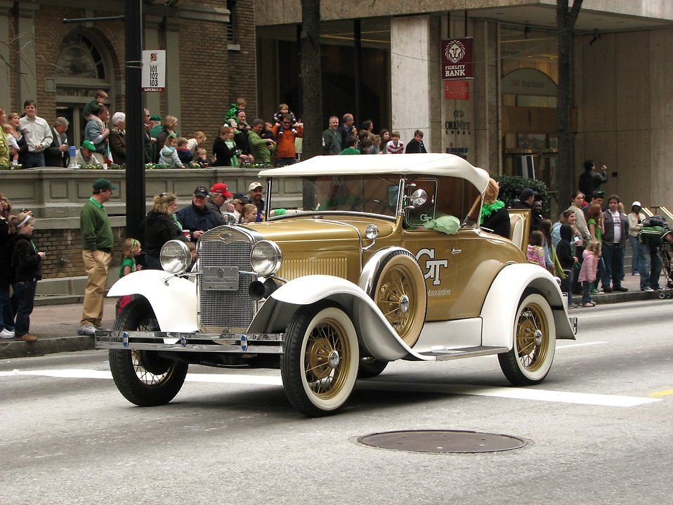 An antique car in the 2010 Saint Patricks Day Parade in Atlanta, Georgia : Free Stock Photo