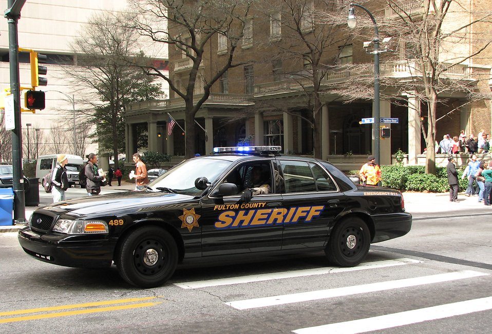 A police car in the 2010 Saint Patricks Day Parade in Atlanta, Georgia : Free Stock Photo