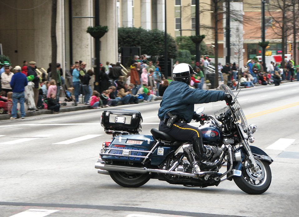 A police officer on a motorcycle clearing the street for the 2010 Saint Patricks Day Parade in Atlanta, Georgia : Free Stock Photo