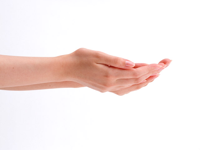 A pair of open hands isolated on a white background.